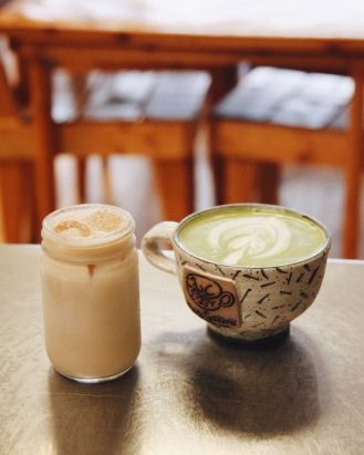 iced chai latte and hot matcha latte at bar