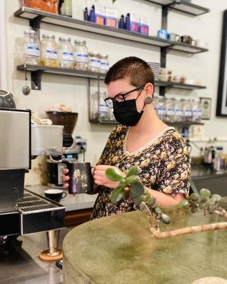 Barista Emily at the espresso machine